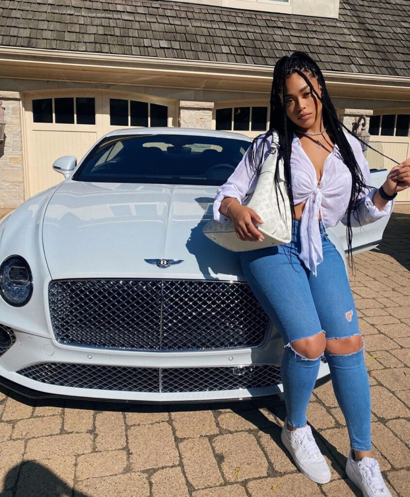 Jordyn Woods with her Bentley Car