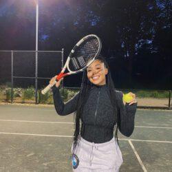 Playing tennis smiling