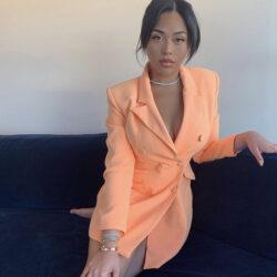 Wearing orange suit