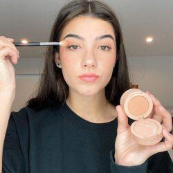 Charli damelio applying makeup around eyes