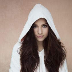 Mackenzie wearing white hoody scaled