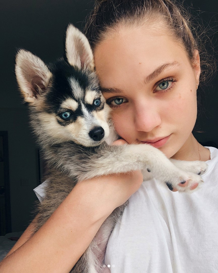 Maddie with a dog