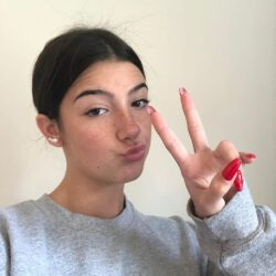 Red nails peace sign