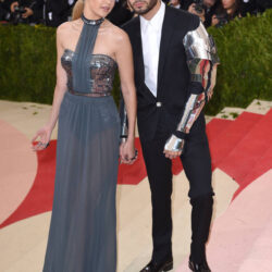 Gigi with zayn at red carpet wearing metal outfits