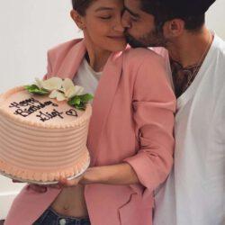 Zayn kiss gigi for her birthday with cake