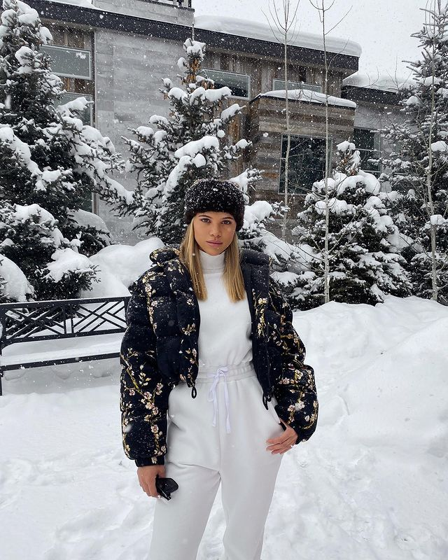 Outside in snow white outfit