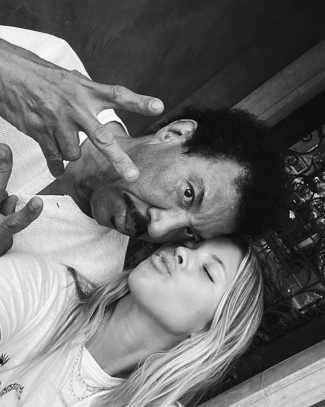 With her father lionel richie